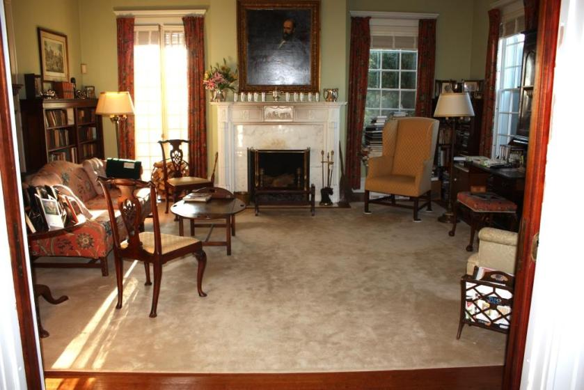 The library is used daily by the family to read, play games, greet guests, and even watch TV.