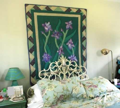 The iris quilt is hanging with Velcro dots on a piece of trim.