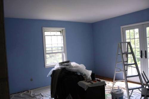 After one coat the master bedroom is blue with a pale pink ceiling.