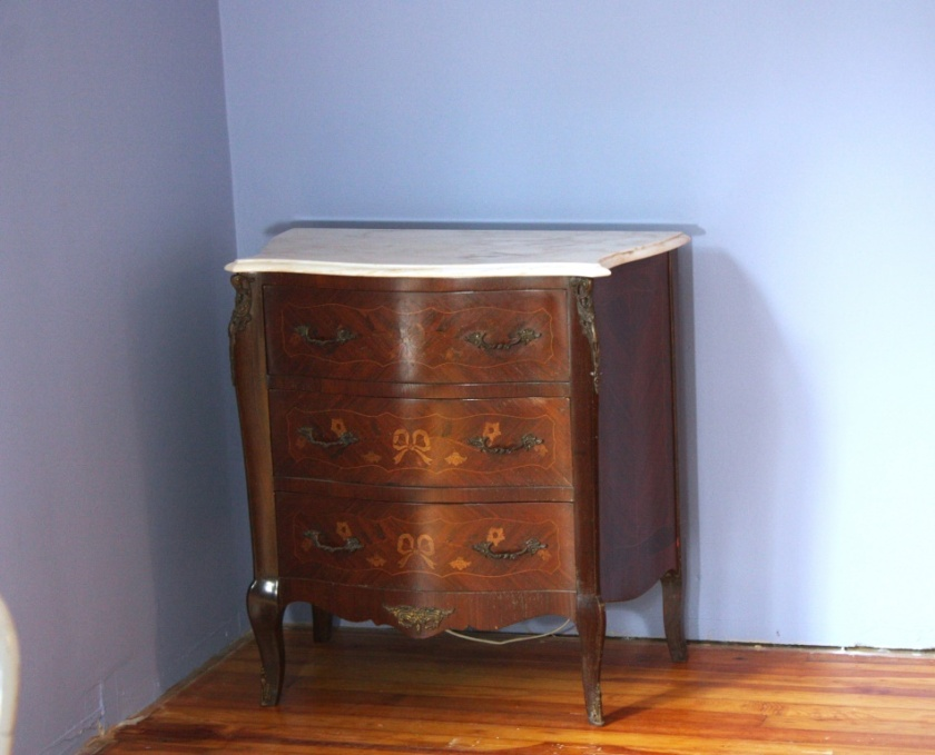 I like that it sort of goes with our antiques bombe chests we're using as side tables in the master bedroom.