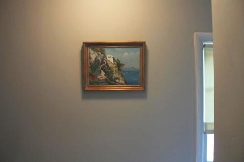 The frame is burnished gold leaf.