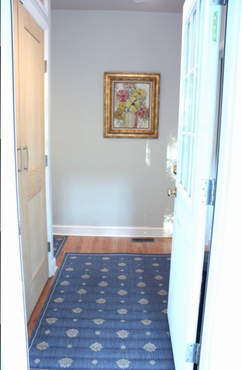 The mudroom is entered from the side porch.