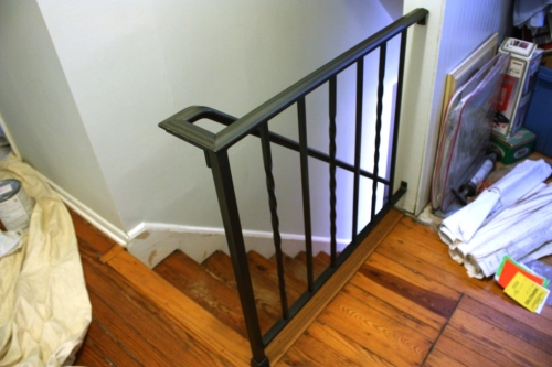 The long part of the railing that goes down the stairs bolts to the top section.
