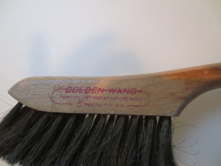 """Removes lint -- renews nap like magic"" as printed on the brush"