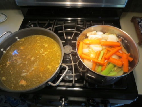 Pan drippings reducing on the left -- stock pot ready for action on the right.