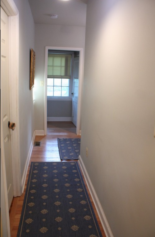 The hall between the mudroom and the kitchen is still bare.