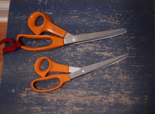 I have lots of orange-handled scissors but the ones with a ribbon tied to the handle are for FABRIC ONLY.