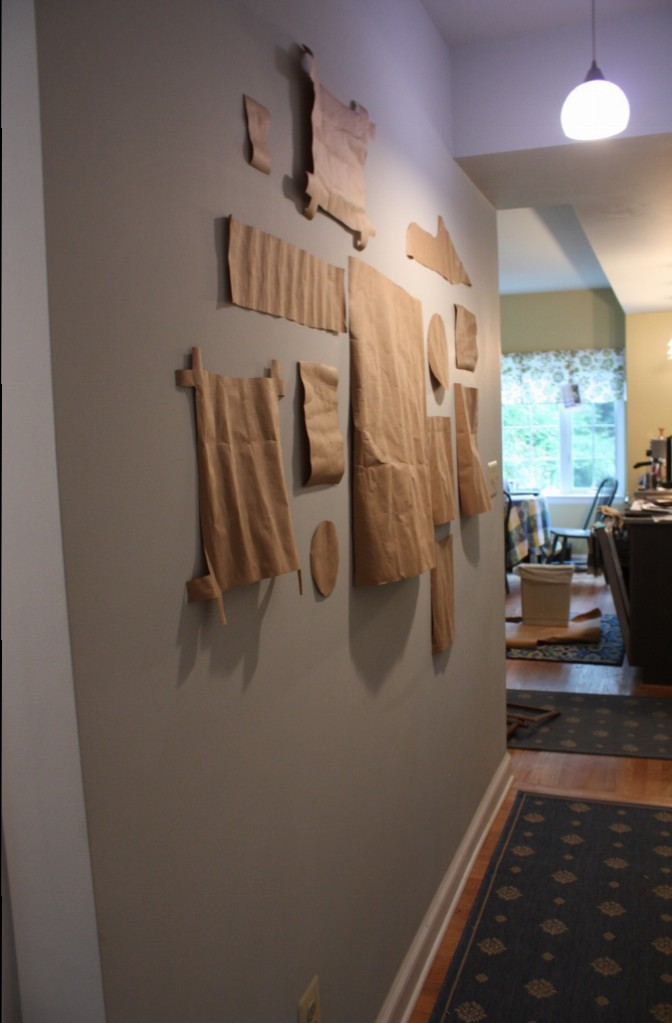 I cut out some of the shapes in brown paper and hung them on the wall between the mudroom and the kitchen.