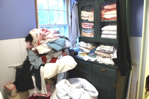 During the renovation we've been using the laundry room to stash almost everything we own of a fabric variety.