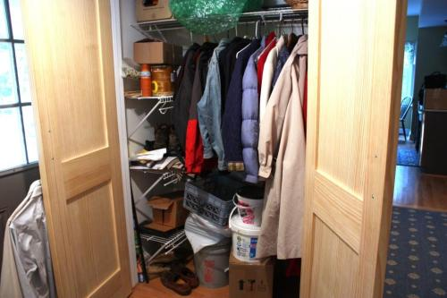 Coats and boots belong in this closet.