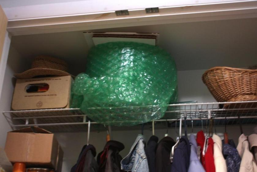 I don't mind the vintage slide projector in the closet but the bubble wrap has got to go.  I know the perfect place.