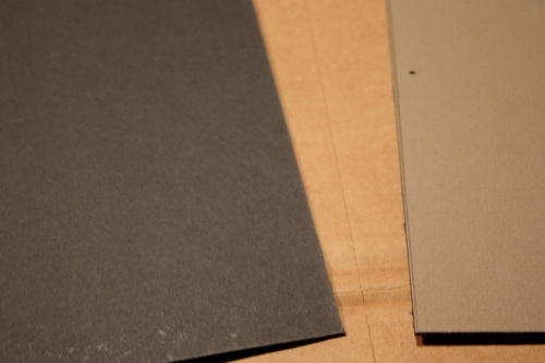 The underside of the mat board is black, the top is taupe. It could be used either way.