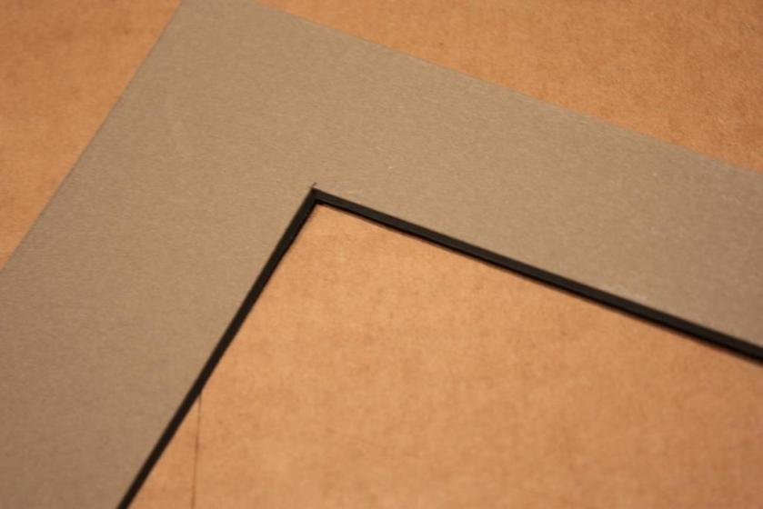 The beveled inner edge of the mat.
