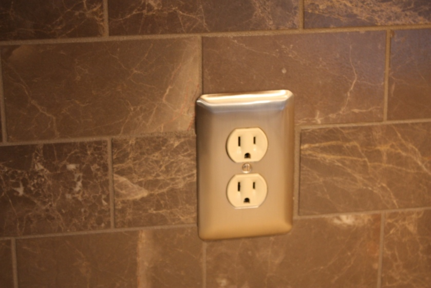 The outlet was replaced with one in which we could insert a plug.