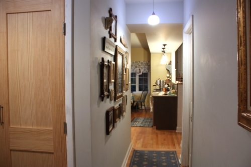 The gallery wall is on the left when entering the kitchen from the mudroom.