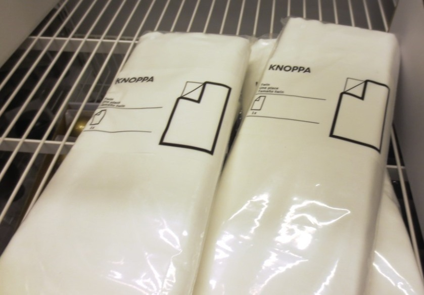 4 packages of white flat sheets