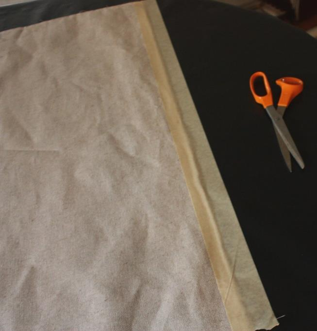 Wide masking tape holds the fabric to the roller.