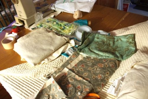 The dining room table is covered with potential sewing projects.