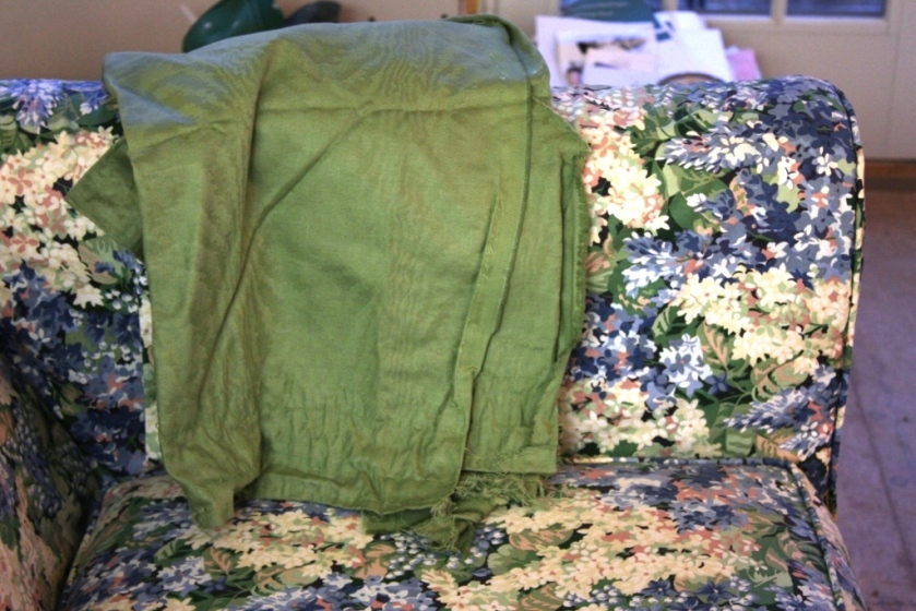 The green fabric is picked up in the leaves of the loveseat covers.