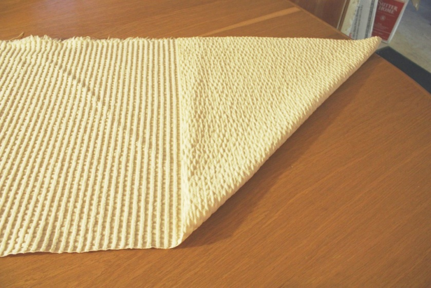 I cut along one of the wales to make a square pillow top.