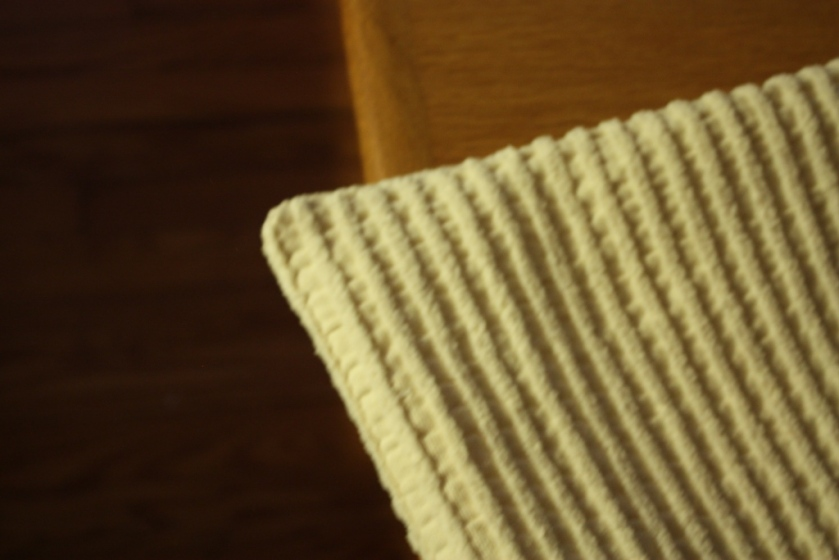 The pillow covers have nice corners achieves by making 3 angled cut close to the stitching line.