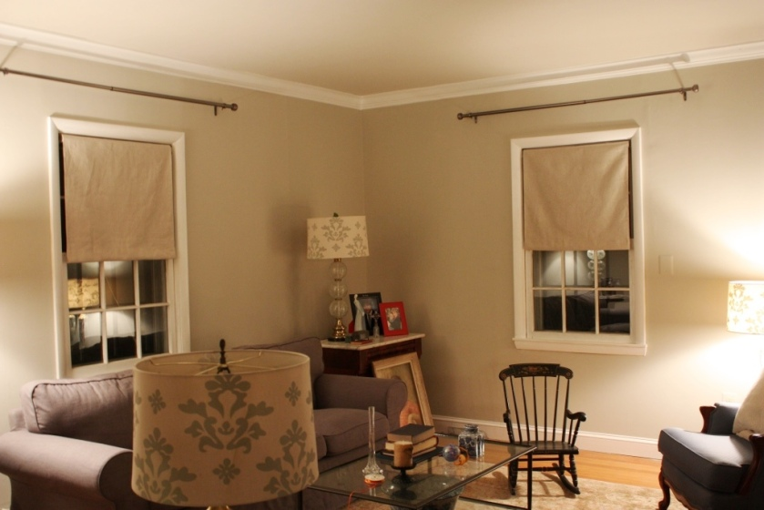 Pewter curtain rods above the living room window.