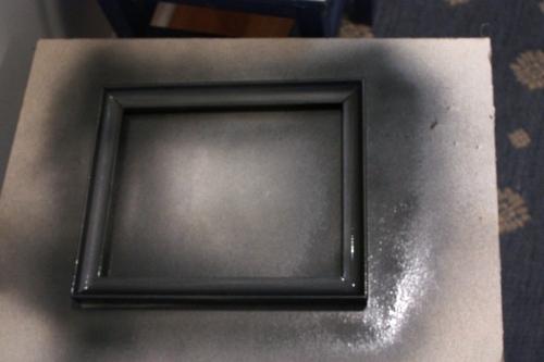 Charcoal metallic spray paint.