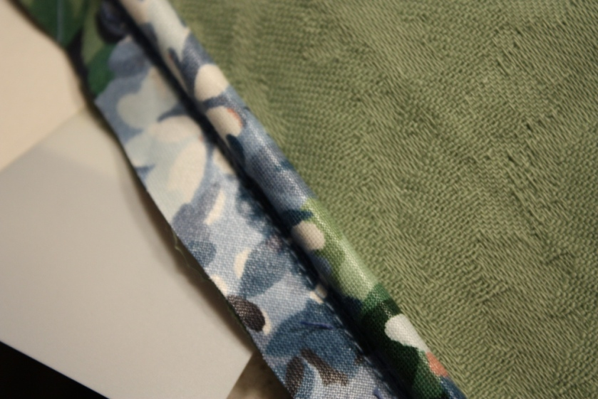 The flowered fabric is a bias strip wrapped around a piece of upholstery cord.