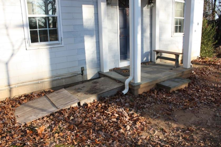 Making the turn into the front door would be difficult with the ramp on the side of the front porch.