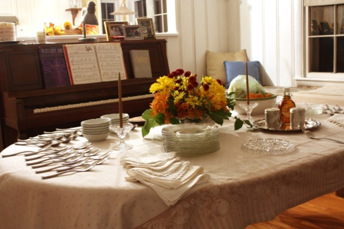 The dining room is prepared for a breakfast buffet.