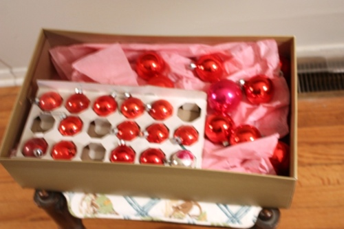 At least 5 dozen red Christmas balls are on their way to new surroundings.