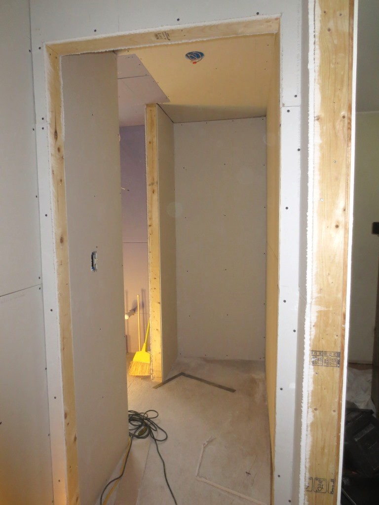 The hallway between the master bedroom and The closet and bathroom needs to be finished including the ceiling.