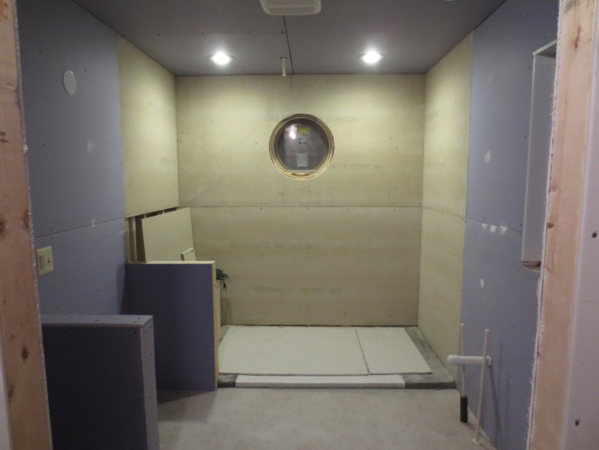 Master bathroom - install one piece of cement board and mud all drywall.