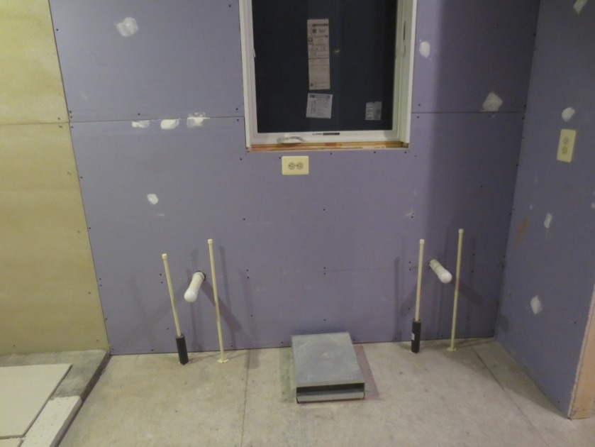 "This area from the cement board on the left to the purple wall on the right is 6'-11"" long.  Here's were the double vanity goes."