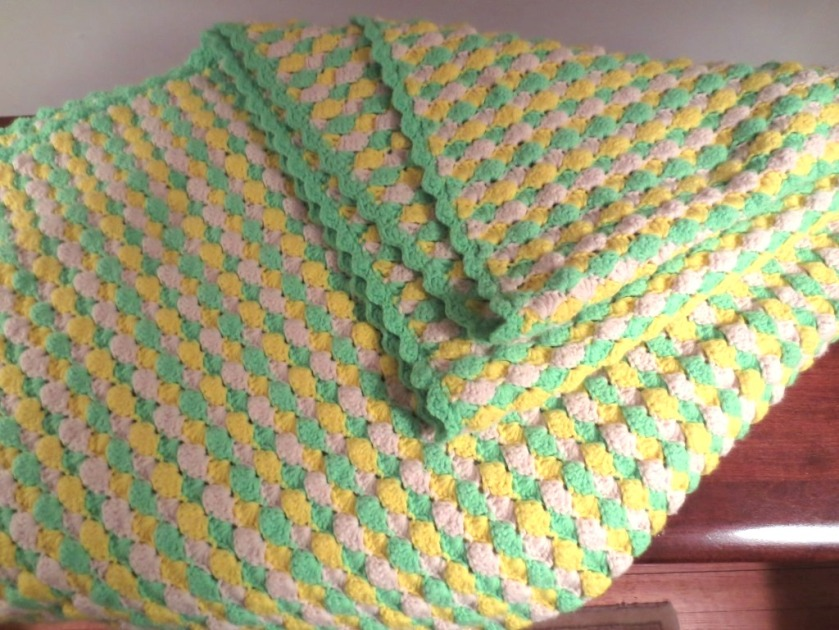Spring green, yellow, and ecru in a shell pattern stitch.