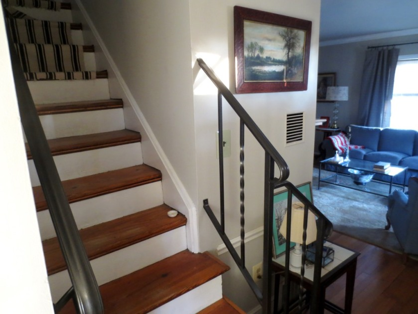 Our stairs are so narrow we rarely store anything there for long. (See how the painting looks on the entry wall?)