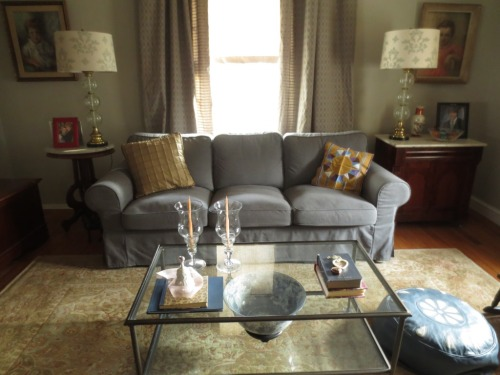The yellow PB pillows would add a sunny spark to this cool living room.