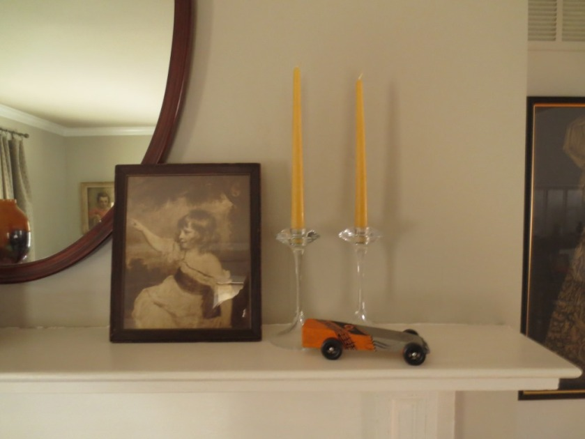 An old print, beeswax candles, and my  champion pine car.