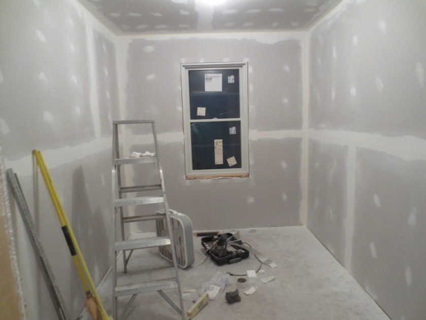 The master closet is almost ready for primer after a wipe-down with a wet sponge.