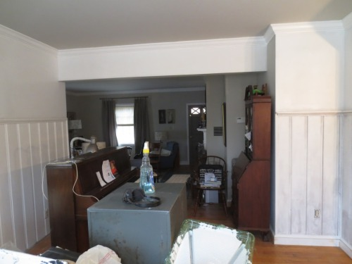 The ceiling in the dining room is Revere Pewter which helps the white cornice molding to stand out.