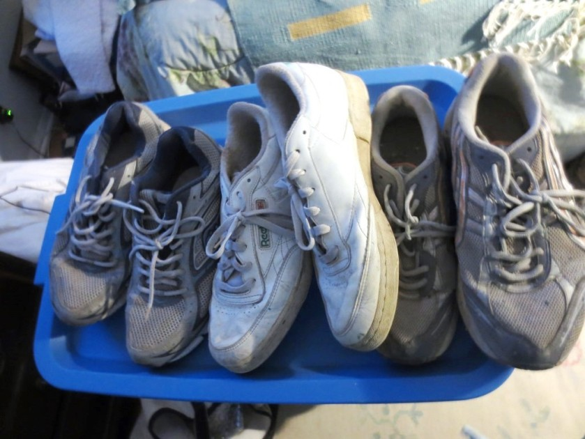 Athletic shoes - an old pair, a new pair, and a pair for working in the yard.