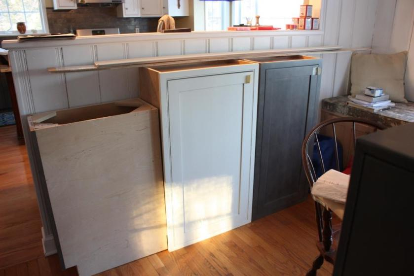 We have one white wall cabinet, one grey wall cabinet, and a smaller grey floor cabinet (turned sideways in the photo).