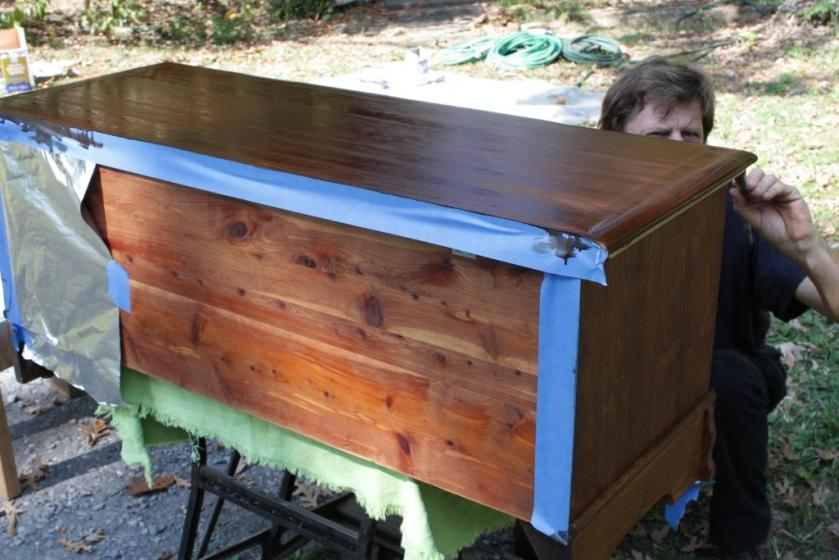 Charlie used painters' tape and aluminum foil to keep stain from dripping onto the bare cedar back and interior.