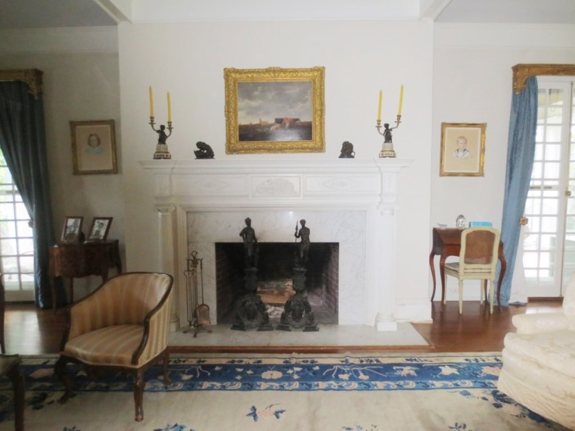 The hearth and fire surround are white marble.