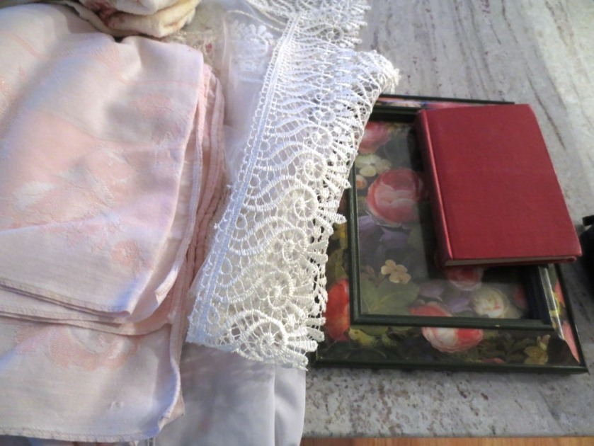 A frame covered with roses and a small musical dictionary.