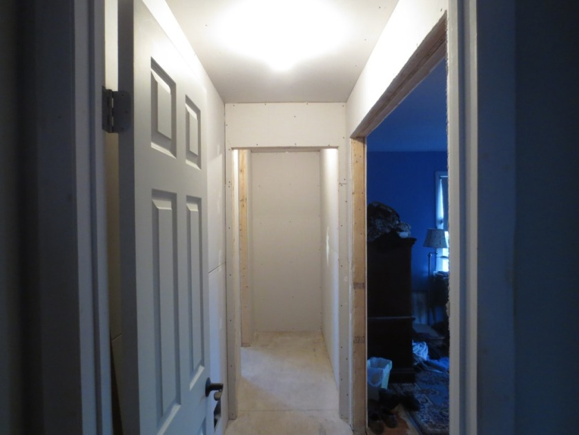 The same exact hallway decluttered. We're expecting to put a linen closet at the far end.