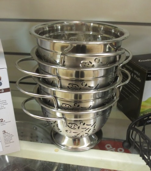 A stack of petite colanders was really attractive.