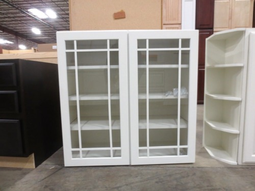 I have my eye on this 36-inch wide glass front cabinet for our linen closet -- $150.