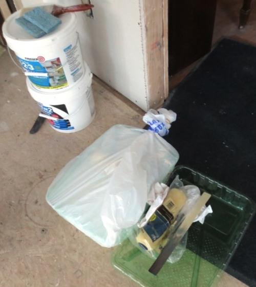 Primer, paint brush, roller, roller pan, paint stir, and rags.
