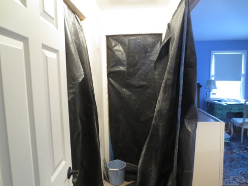 Black plastic is hug at every opening in the master suite to keep the drywall sanding dust at bay.
